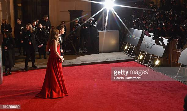 Hannah Bagshawe and Eddie Redmayne attends the EE British Academy Film Awards at the Royal Opera House on February 14 2016 in London England