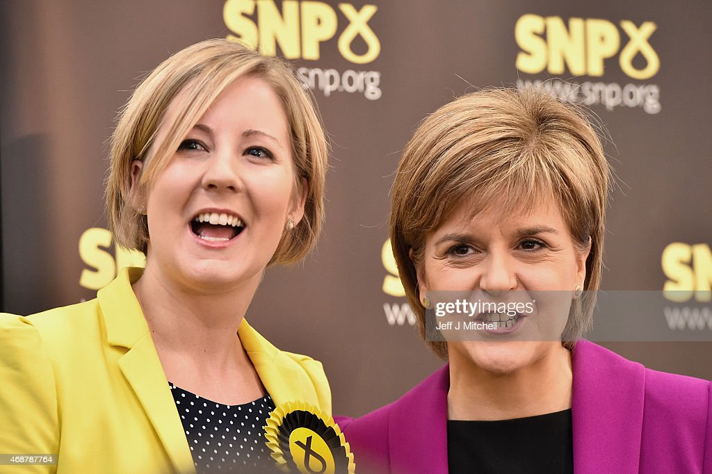 Hannah Bardell SNP candidate for Livingston joins Scotland's First Minister Nicola Sturgeon (R) as she gives a speech setting out the SNP's plans to reduce child poverty at Forestbank Community Centre on April 7, 2015 in Livingston, Scotland.The First Minister announced that SNP MP's will use their influence after May's election to combat child poverty in Scotland and across the UK.