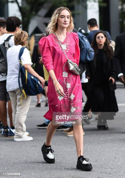 Hannah Baxter is seen wearing a pink and silver print dress outside the Carolina Herrera show during New York Fashion Week S/S20 on September 09,...