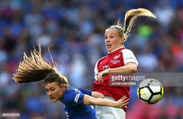 Hannah Blundell of Chelsea and Beth Mead of Arsenal battle for an aerial ball during the SSE Women's FA Cup Final match between Arsenal Women and...