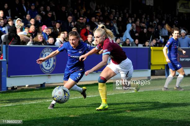 Hannah Blundell of Chelsea battles for possession with Alisha Lehmann of West Ham United during the FA Women's Super League match between Chelsea...