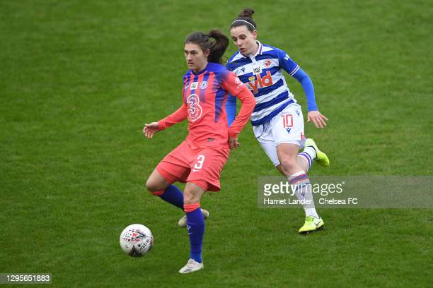 Hannah Blundell of Chelsea is challenged by Lauren Bruton of Reading during the Barclays FA Women's Super League match between Reading Women and...