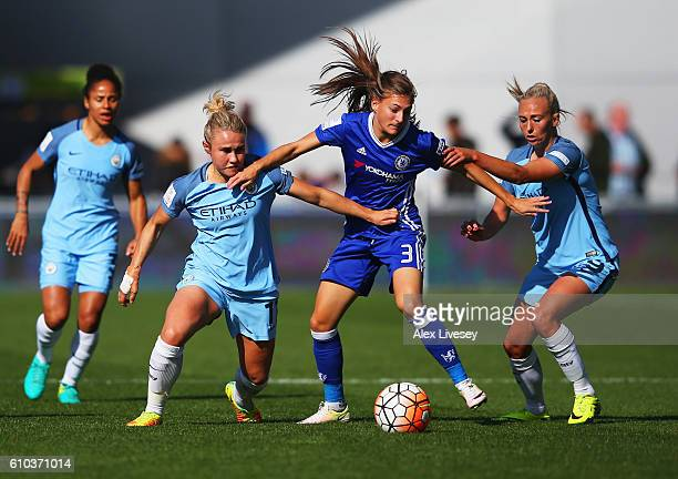 Hannah Blundell of Chelsea Ladies battles with Isobel Christiansen and Toni Duggan of Manchester City Women during the WSL 1 match between Manchester...