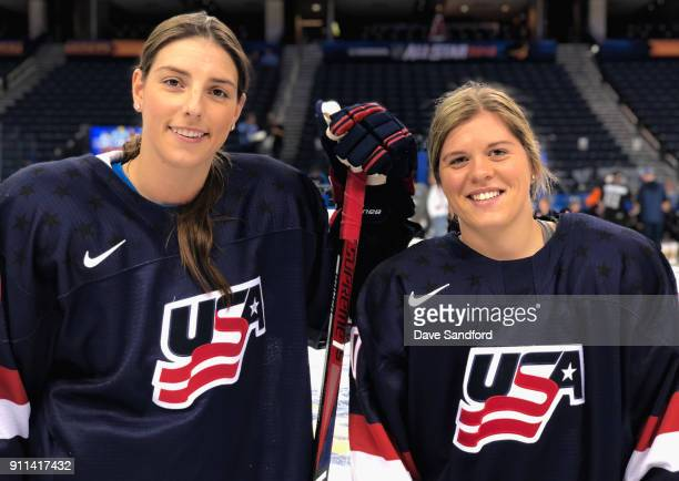 Hannah Brandt and Hilary Knight of the USA Women's hockey team pose on the ice after a run through for the Skills Competition as part of the 2018 NHL...