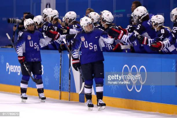 Hannah Brandt of the United States celebrates with teammates after scoring a goal in the third period against Olympic Athletes from Russia during the...