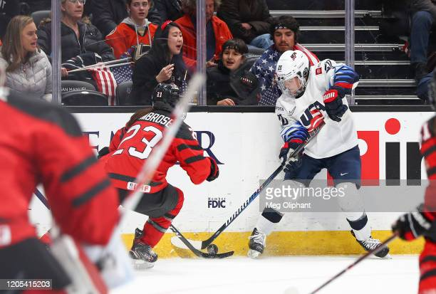 Hannah Brandt of the U.S. Women's Hockey Team and Erin Ambrose of the Canadian Women's National Team fight for the puck at Honda Center on February...