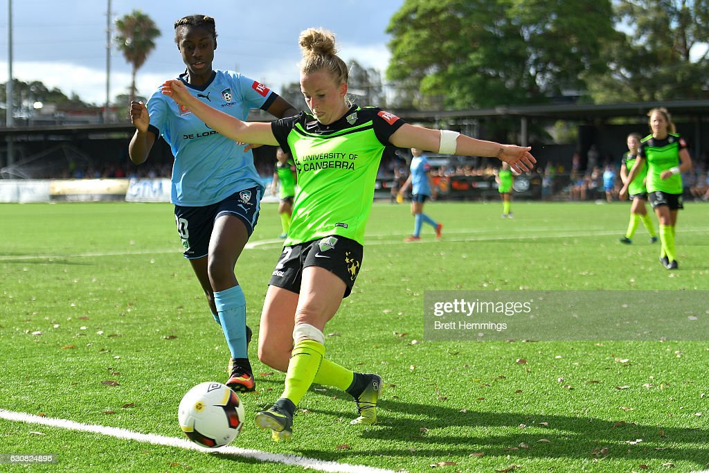 Hannah Brewer of Canberra and Princess Ibini-Isei of Sydney contest the ball during the round 10 W-League match between Sydney and Canberra at Lambert Park on January 3, 2017 in Sydney, Australia.