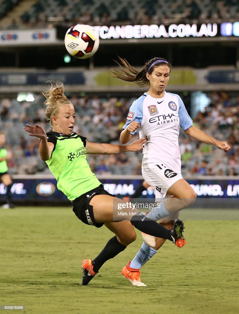 Hannah Brewer of Canberra clears as she is challenged by Erika Tymrak of Melbourne City during the W-League Semi Final match between Canberra United and Melbourne City FC at GIO Stadium on February 5, 2017 in Canberra, Australia.