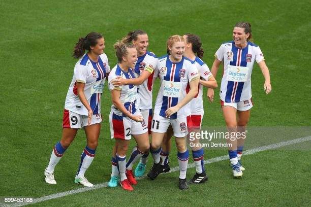 Hannah Brewer of the Jets celebrates her goal with her teammates during the round nine WLeague match between the Melbourne Victory and the Newcastle...