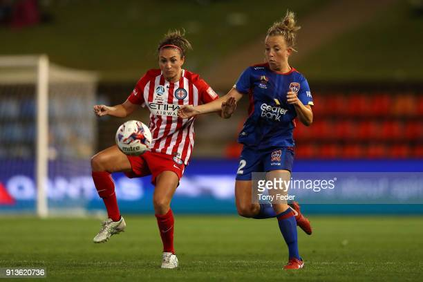 Hannah Brewer of the Jets competes for the ball with her City opponent during the round 14 WLeague match between the Newcastle Jets and Melbourne...