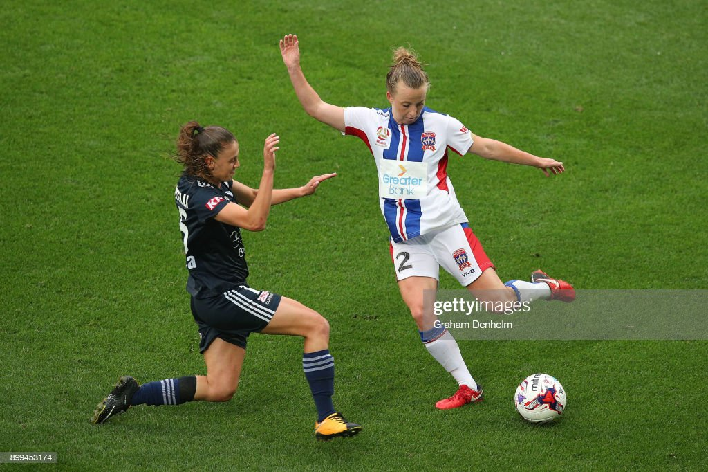 Hannah Brewer of the Jets (R) gets a pass away under pressure during the round nine W-League match between the Melbourne Victory and the Newcastle Jets at AAMI Park on December 29, 2017 in Melbourne, Australia.