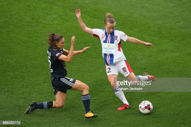 Hannah Brewer of the Jets gets a pass away under pressure during the round nine WLeague match between the Melbourne Victory and the Newcastle Jets at...