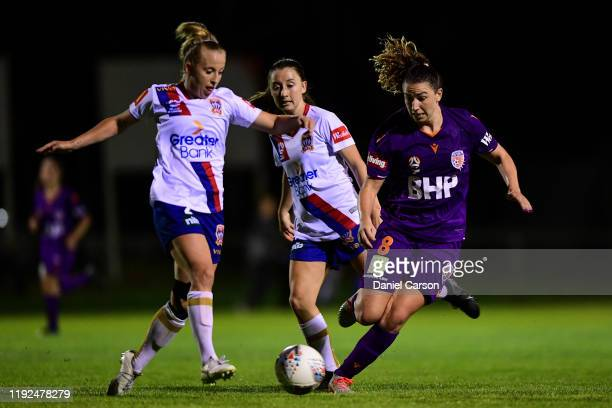 Hannah Brewer of the Newcastle Jets competes for the ball against Morgan Andrews of the Perth Glory during the round four W-League match between the...