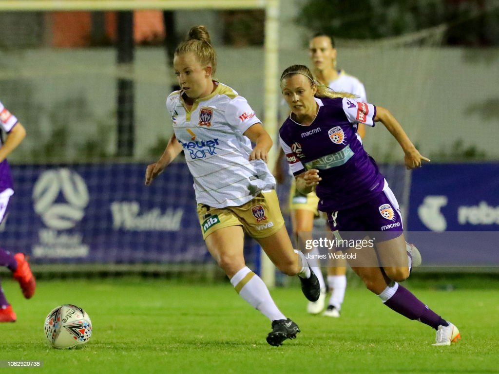 Newcastle Jets: Hannah Brewer Of The Newcastle Jets Runs The Ball Out To