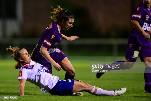 Hannah Brewer of the Newcastle Jets slides in for a tackle against Morgan Andrews of the Perth Gloryduring the round four W-League match between the...