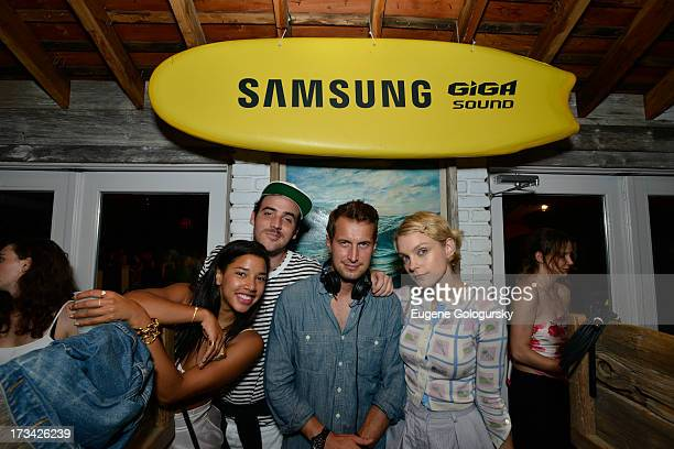 Hannah Bronfman and beau Brendan Fallis in the DJ booth showing model Jessica Stam the ropes on Samsung's brand new Giga Sound system at Surf Lodge...