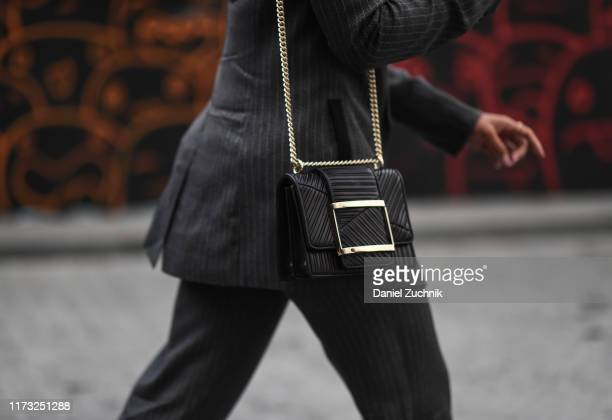 Hannah Bronfman is seen wearing a Jason Wu suit with black leather bag outside the Jason Wu show during New York Fashion Week S/S20 on September 08,...
