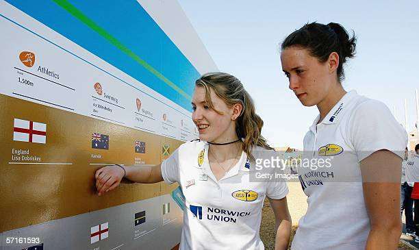 Hannah Brooks and Nicola Maddick look at Lisa Dobriskey's name on the Wall of Fame whilst on a visit to the Commonwealth Games Athletes Village March...
