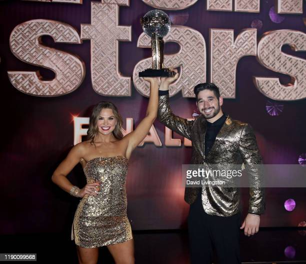 Hannah Brown and Alan Bersten pose at Dancing with the Stars Season 28 Finale at CBS Television City on November 25 2019 in Los Angeles California