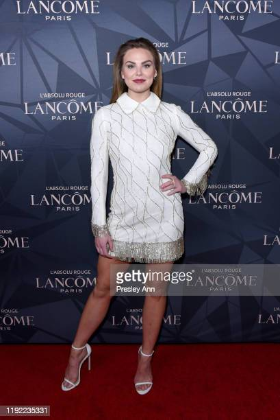 Hannah Brown attends Lancôme x Vogue L'Absolu Ruby Holiday Event at Raspoutine on December 05 2019 in West Hollywood California