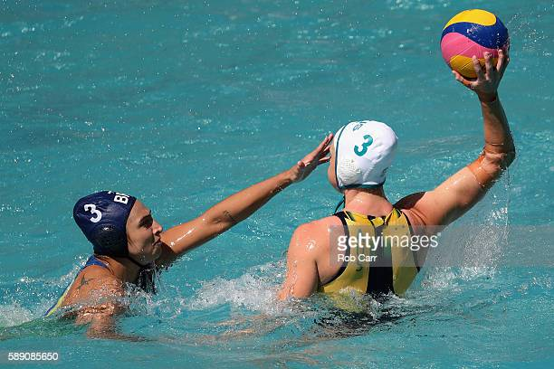 Hannah Buckling of Australia passes over Marina Zablith of Brazil during the Womens Preliminaries on Day 8 of the Rio 2016 Olympic Games on August 13...