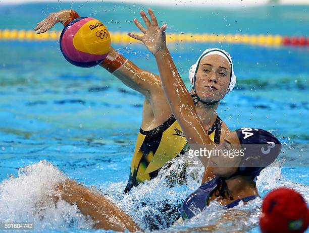 Hannah Buckling of Australia takes a shot as Marina Zablith of Brazil defends during the Women's Water Polo at Olympic Aquatics Stadium on August 17...
