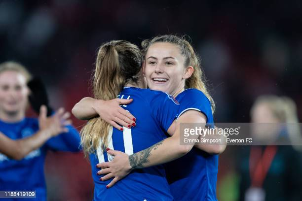 Hannah Cain and Simone Magill embrace at the end of the Barclays FA Women's Super League match between Liverpool and Everton at Anfield on November...