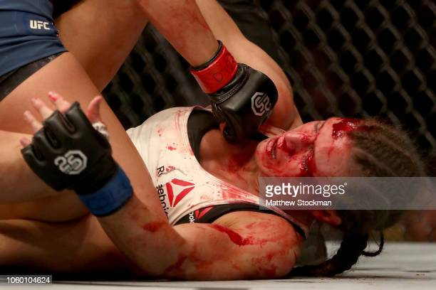 Hannah Cifers is bloodied by Maycee Barber in their Women's Strawweight bout during the UFC Fight Night 139 at the Pepsi Center on November 10, 2018...