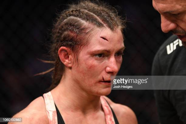 Hannah Cifers reacts after being defeated by Maycee Barber in their women's strawweight bout during the UFC Fight Night event inside Pepsi Center on...