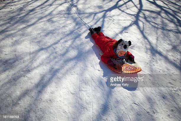Hannah Ciniglio plays on her sled following a major winter storm on February 9 2013 in New York City New York City and much of the Northeast received...
