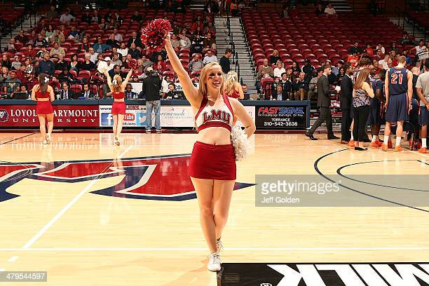 Hannah Clark of the Loyola Marymount Lions Cheer Team performs during the first half of the game against the Pepperdine Waves at Gersten Pavilion on...