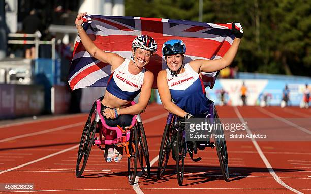 Hannah Cockcroft and Melissa Nicholls of Great Britain celebrate finishing first and third the Women's 100m T34 event during day one of the IPC...
