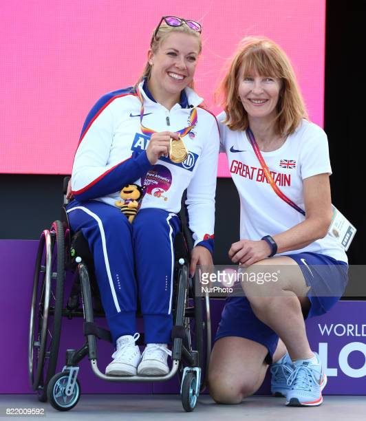 Hannah Cockcroft of Great Britain receive her Gold Meadl for Women's 400m T37 with Coach during World Para Athletics Championships at London Stadium...
