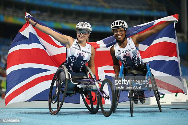 Hannah Cockroft and Kare Adenegan of Great Britain celebrate winning the gold and bronze in the Women's 400m T34 Final on day 7 of the Rio 2016...