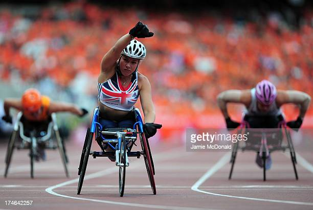 Hannah Cockroft of Great Britain celebrates victory in the Women's T33/34 100mduring day three of the Sainsbury's Anniversary Games - IAAF Diamond...