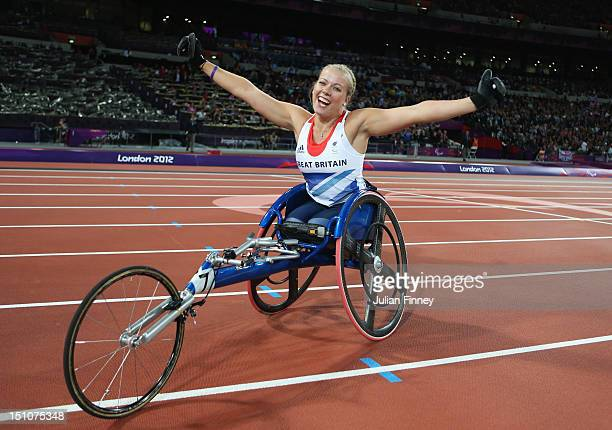 Hannah Cockroft of Great Britain celebrates winning gold in the Women's 100m - T34 Final on day 2 of the London 2012 Paralympic Games at Olympic...