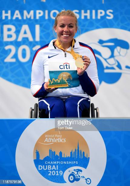 Hannah Cockroft of Great Britain is presented with gold medal after winning the Women's 800m T34 final race on Day Eight of the IPC World Para...