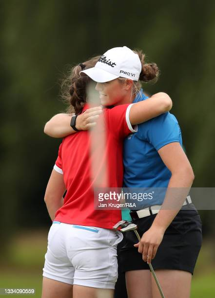Hannah Darling of Broomieknowe and Beth Coulter of Kirkistown Castle shake hands on the 18th green during the Final of the R&A Girls Amateur...