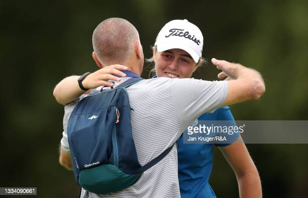 Hannah Darling of Broomieknowe hugs her dad on the 18th hole after winning the Final of the R&A Girls Amateur Championship at Fulford Golf Club on...