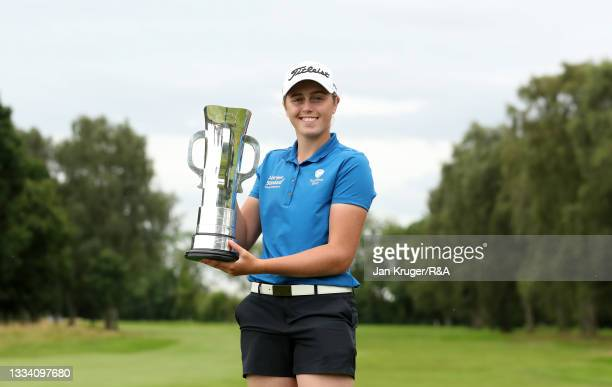 Hannah Darling of Broomieknowe poses with the trophy following victory in the R&A Girls Amateur Championship at Fulford Golf Club on August 14, 2021...