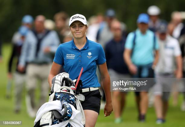 Hannah Darling of Broomieknowe smiles as she walks up to the 18th green during the Final of the R&A Girls Amateur Championship at Fulford Golf Club...