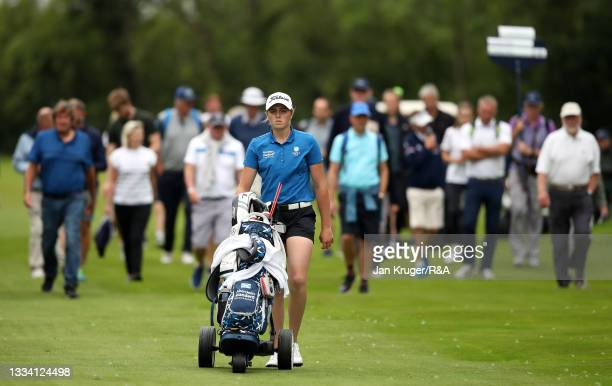 Hannah Darling of Broomieknowe walks up up to the 18th green with crowds following during the Final of the R&A Girls Amateur Championship at Fulford...