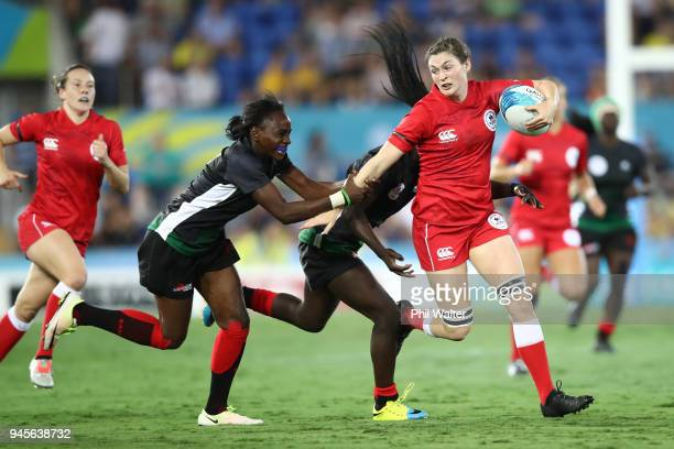Hannah Darling of Canada is tackled in the match between Kenya and Canada during Rugby Sevens on day nine of the Gold Coast 2018 Commonwealth Games...