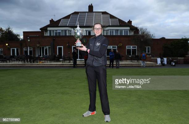 Hannah Darling poses with the trophy after winning the final round of the Girls' U16 Open Championship at Fulford Golf Club on April 29 2018 in York...