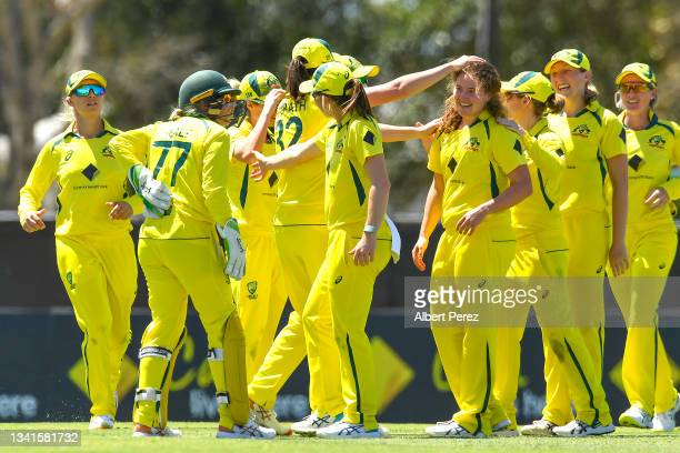 Hannah Darlington of Australia is congratulated by team mates after dismissing Pooja Vastrakar of India during game one of the Women's One Day...