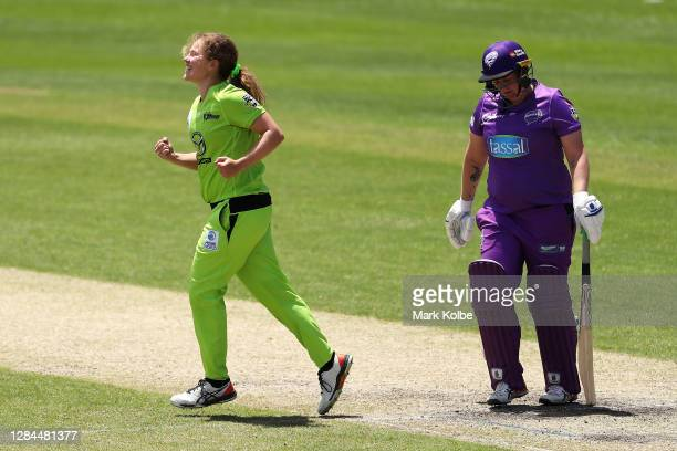 Hannah Darlington of the Thunder celebrates victory as Rachel Priest of the Hurricanes looks dejected after defeat during the Women's Big Bash League...