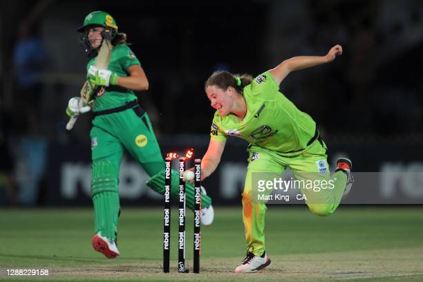 Hannah Darlington of the Thunder runs out Nicole Faltum of the Stars on the last ball of the innings during the Women's Big Bash League Final between...