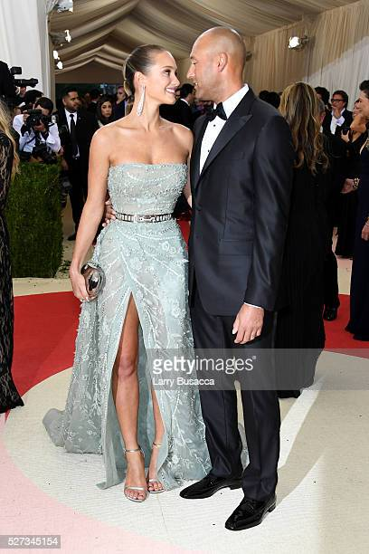 Hannah Davis and Derek Jeter attend the Manus x Machina Fashion In An Age Of Technology Costume Institute Gala at Metropolitan Museum of Art on May 2...