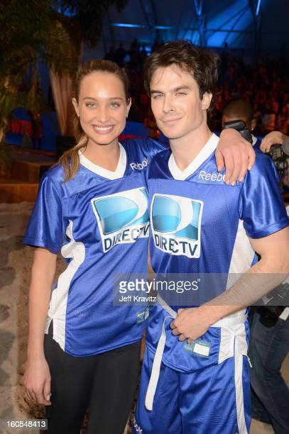 Hannah Davis and Ian Somerhalder attend DIRECTV'S 7th Annual Celebrity Beach Bowl at DTV SuperFan Stadium at Mardi Gras World on February 2 2013 in...