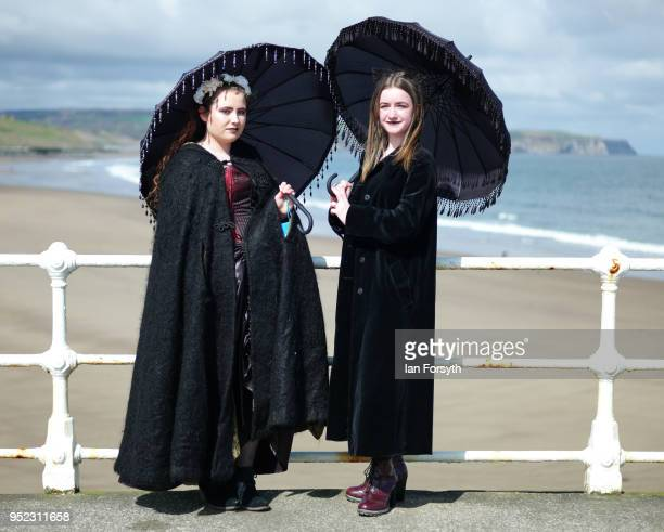 Hannah Dutton and Isla Catherine Grossett from Guisborough pose on the pier as they visit Whitby Gothic Weekend on April 28, 2018 in Whitby, England....